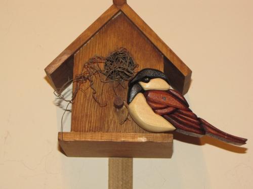 Wooden bird and bird house...