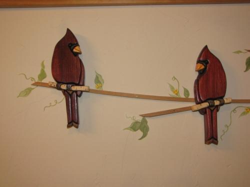 Wooden birds an a homemade branch..